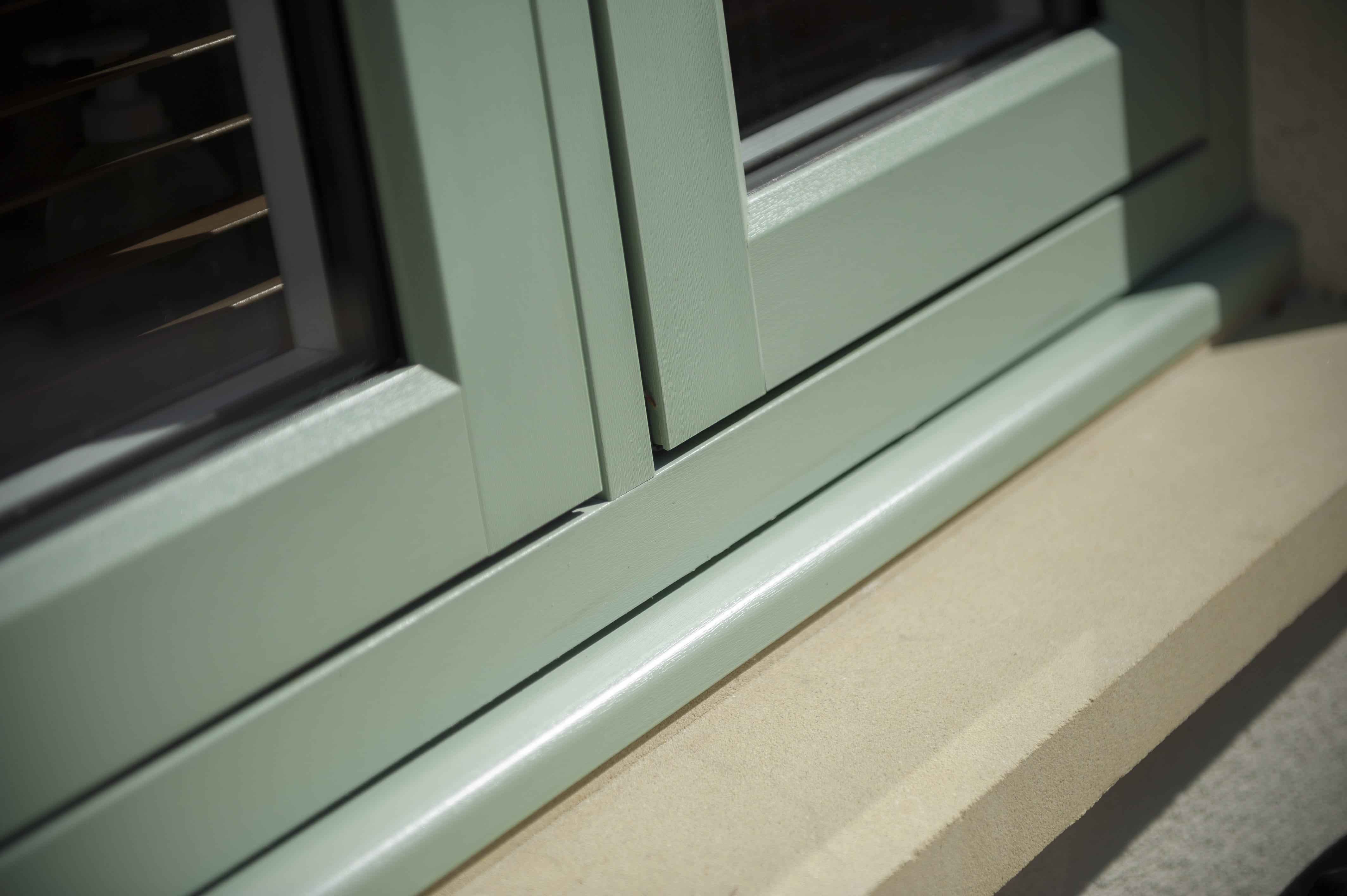 Flush fitting casement window in chartwell green